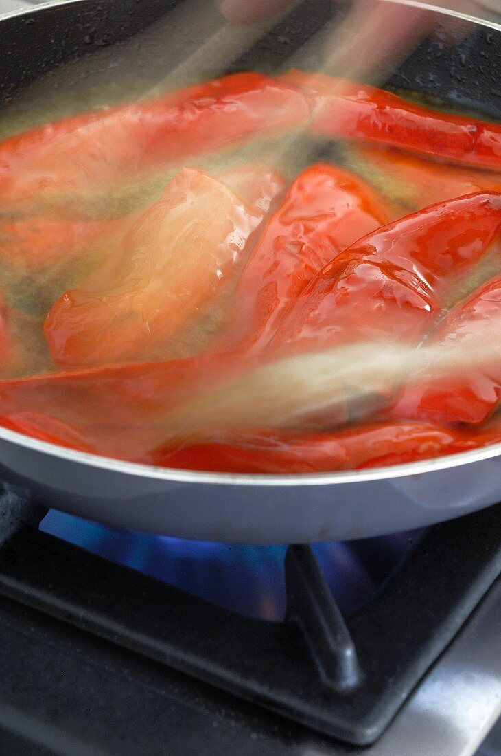 Peppers frying in oil