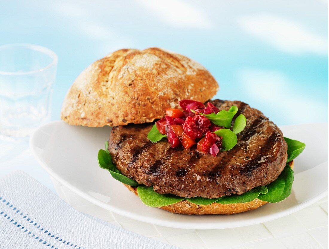 A burger topped with stewed acai berries