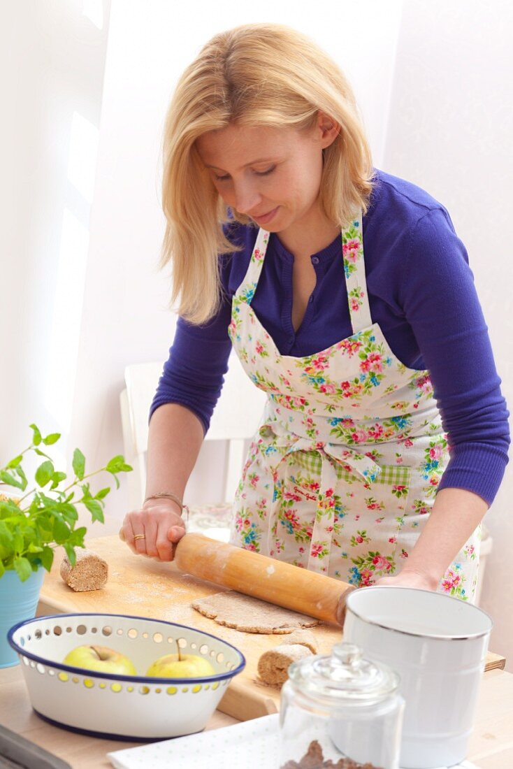 Woman rolling out biscuit dough