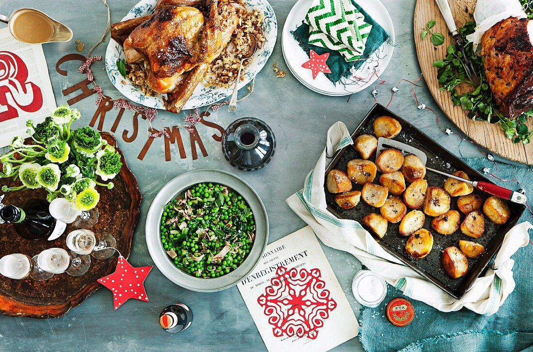 A Christmas buffet with various roasts and side dishes