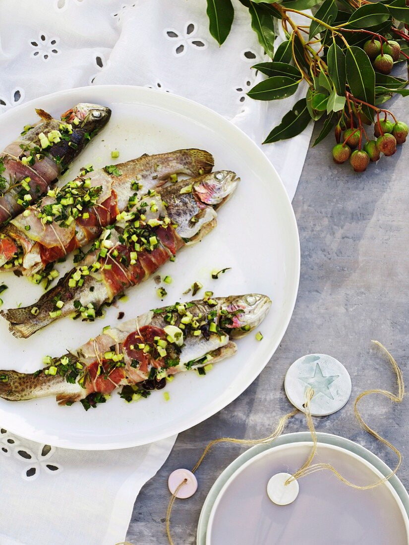 Rainbow trout wrapped in bacon and filled with courgette