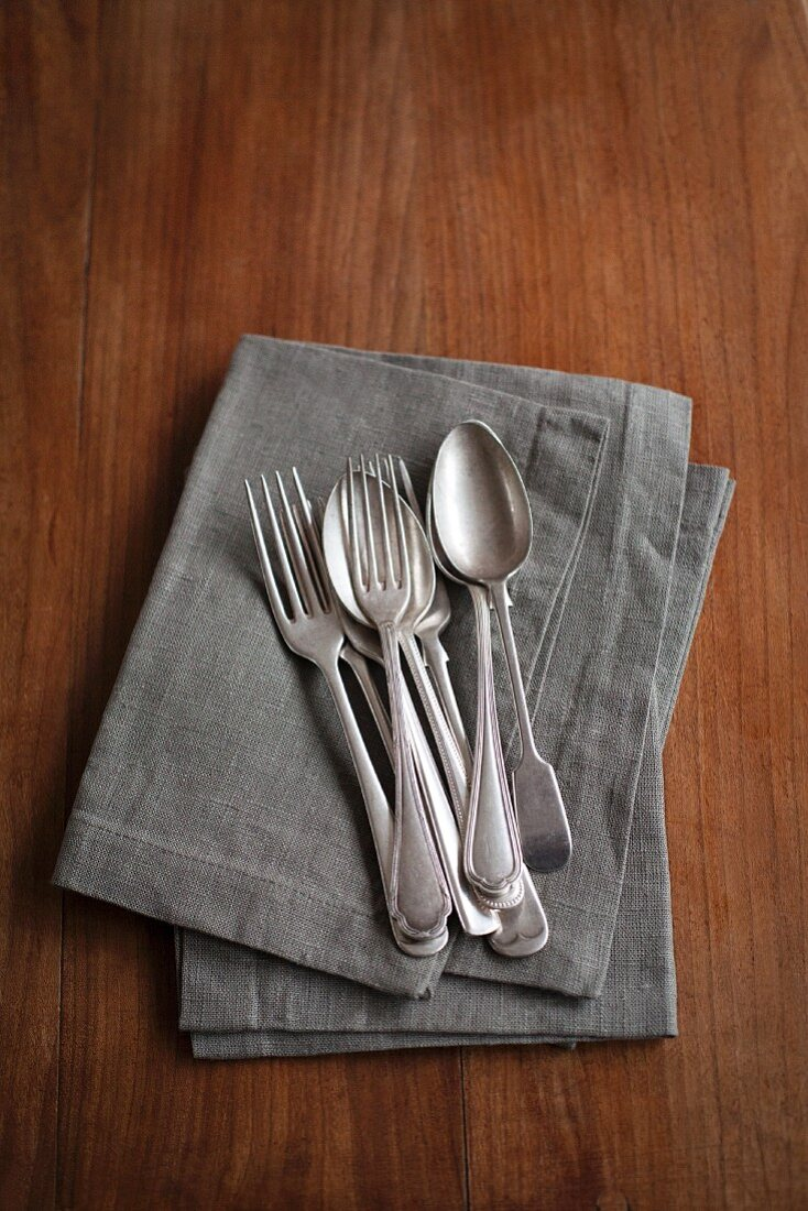 Silver cutlery on a napkin