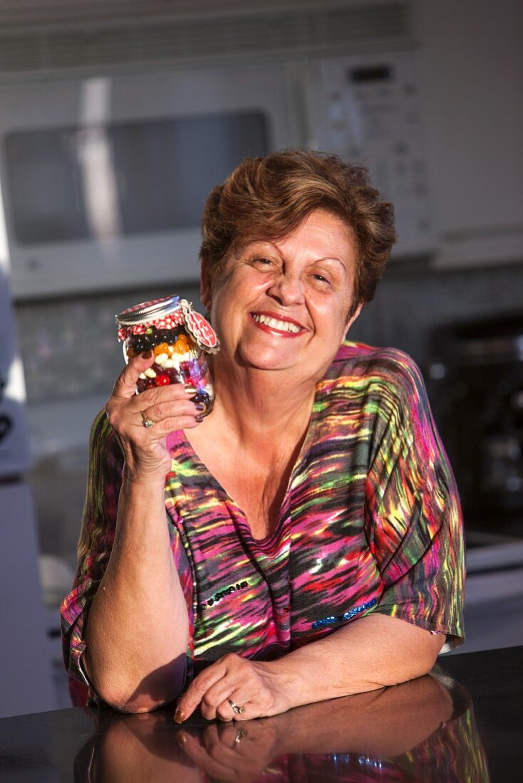 A Woman Holding a Jar of Jelly Beans