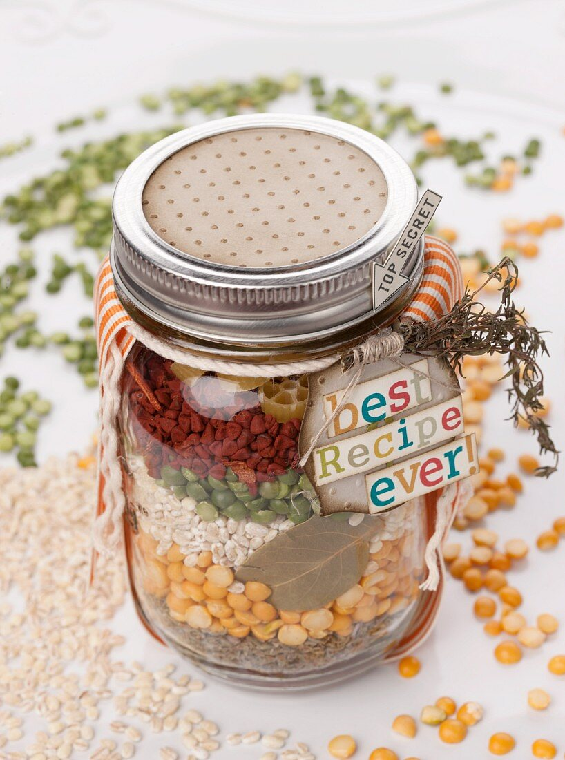 Assorted ingredients for soup in a screw-top jar as a gift
