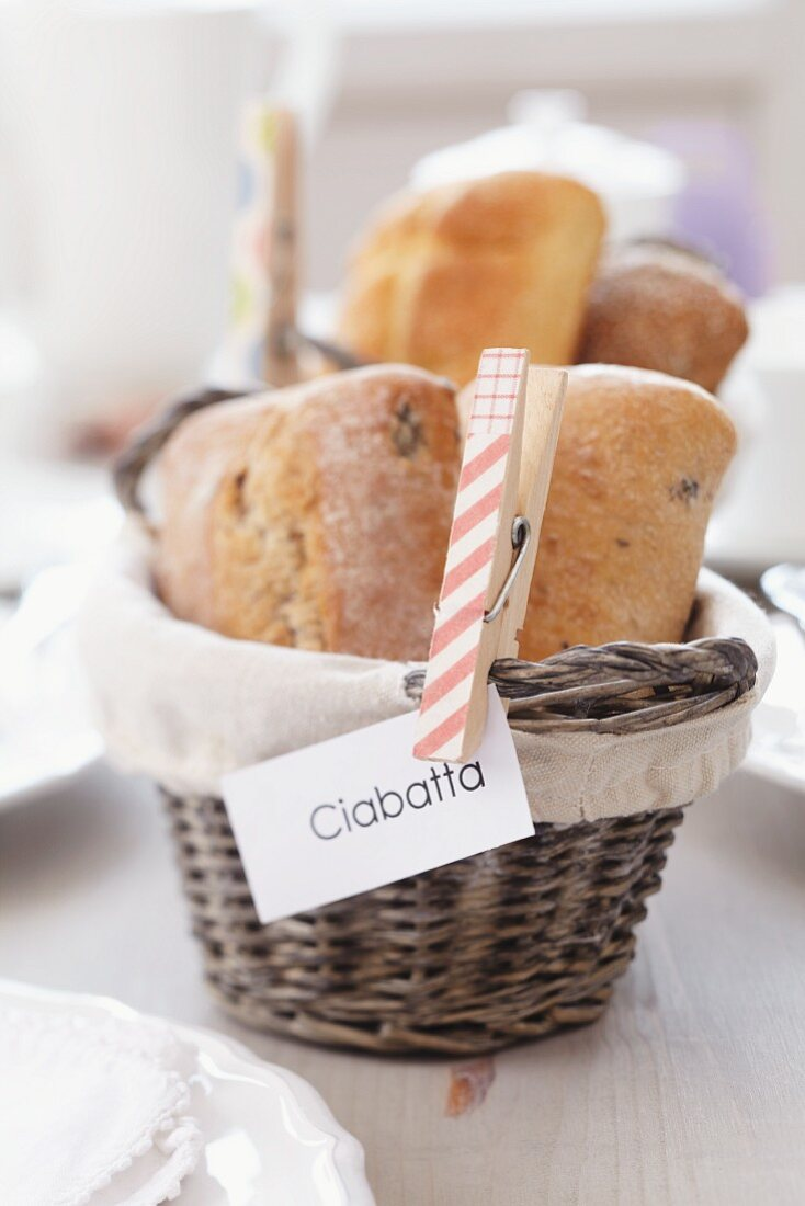Clothes peg holding sign on bread basket