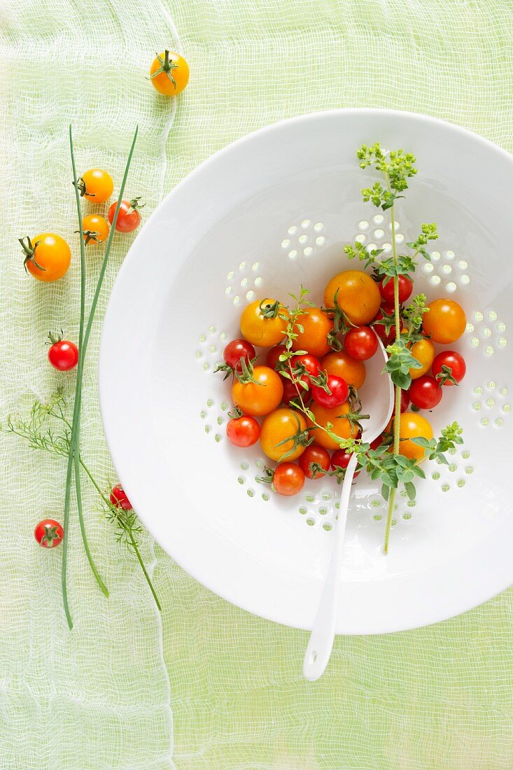 Fresh Cherry Tomatoes in a White Colander