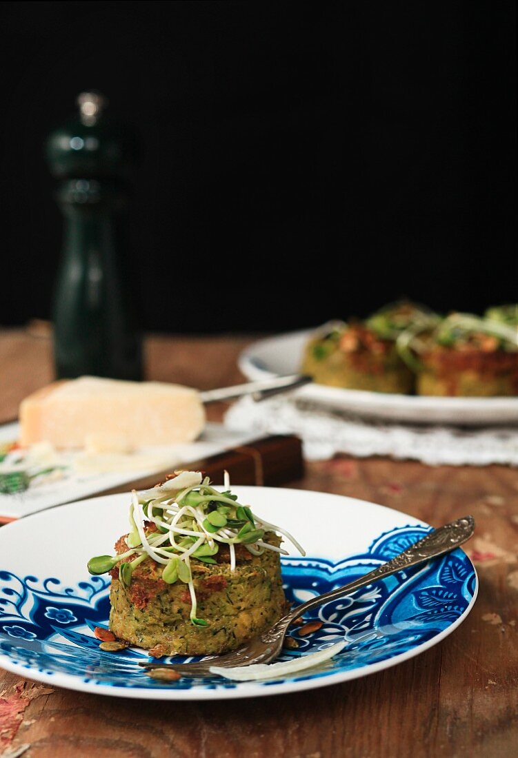 Potato and courgette cake with sunflower sprouts and pumpkin seeds