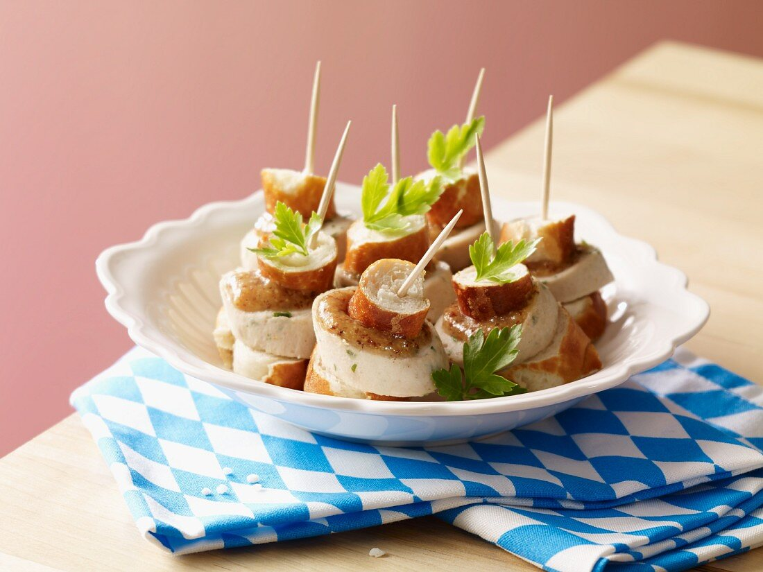 A Bavarian snack: pretzel and white sausage skewers