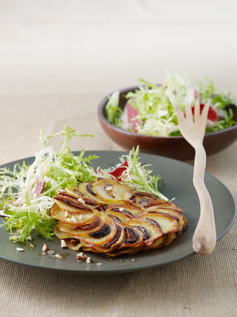 Potato cakes with porcini mushrooms and a side of salad