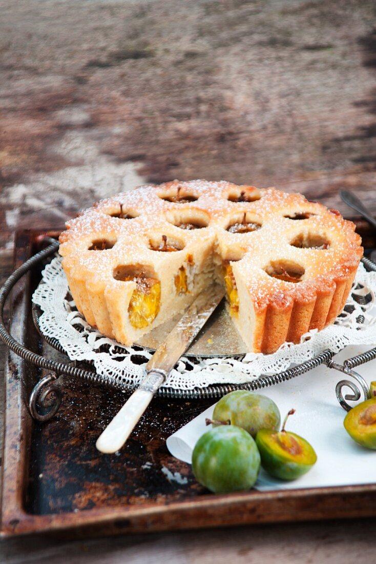 Breton Mirabelle plum cake, one slice removed