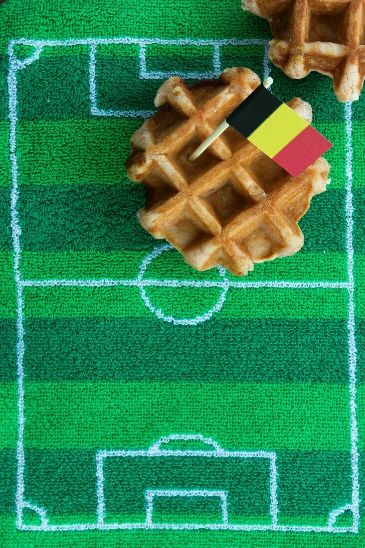 Belgian waffles with a fag and football-themed decoration