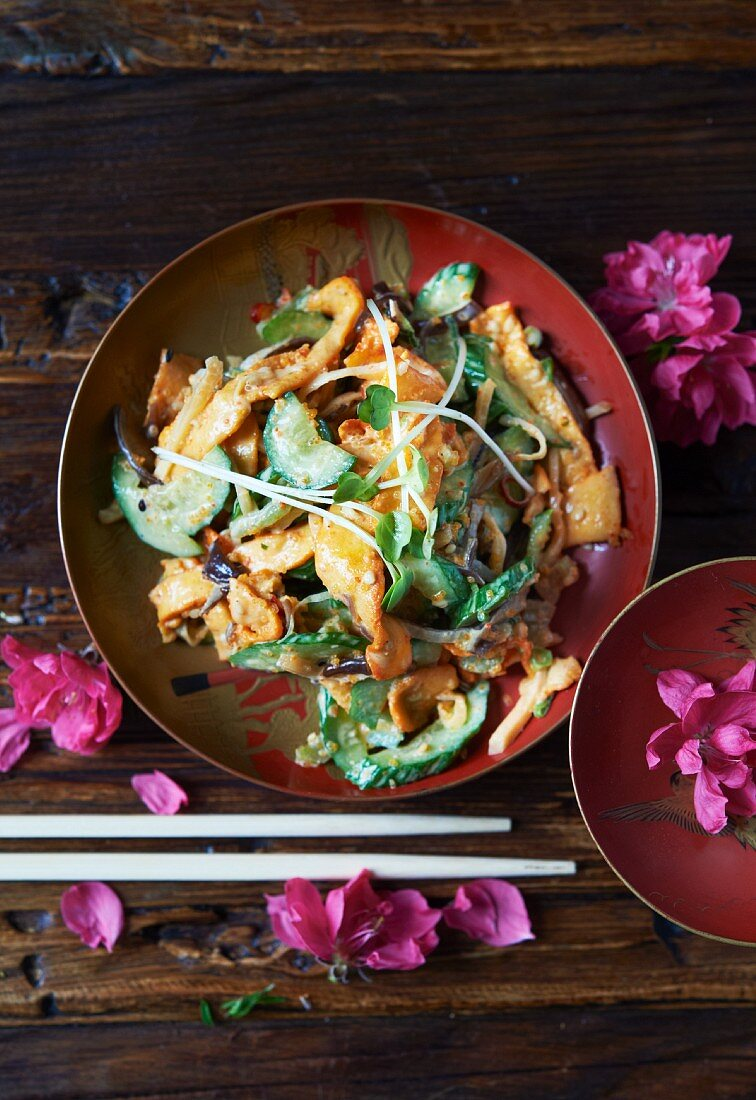 Japanese Squid Salad in a Bowl; Chopsticks and Flowers