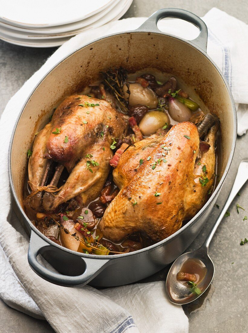 Pot-roast pheasant in a casserole dish