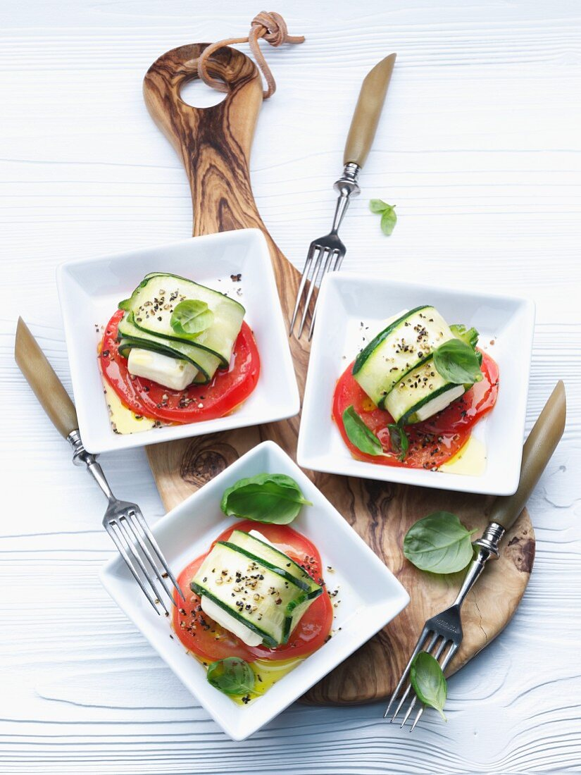 Sheep's cheese wrapped in courgette on slices of tomato