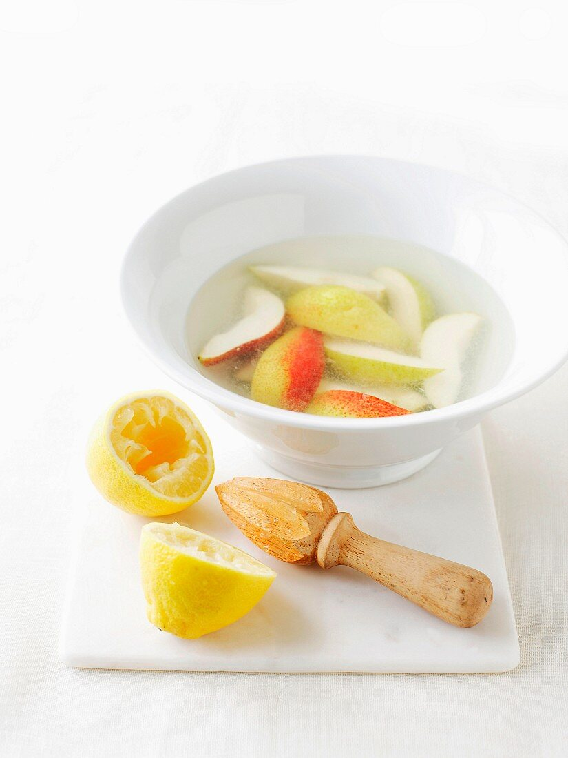 Bowl of water with lemon juice to prevent vegetables from browning
