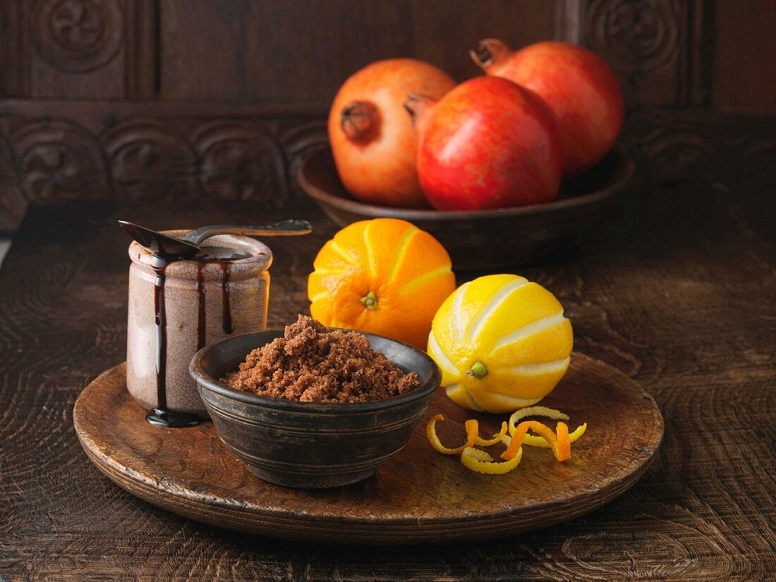 Ingredients for dry cured pork loin. Brown sugar, molasses, pomegranates and orange and lemon rind