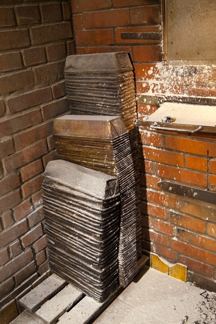 Stacked loaf tins in a bakery