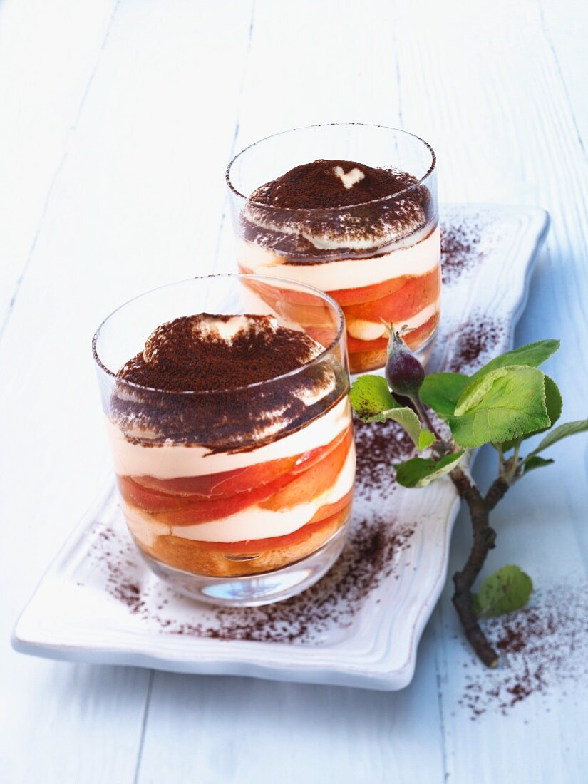 A layered dessert of apple, cream and cocoa powder