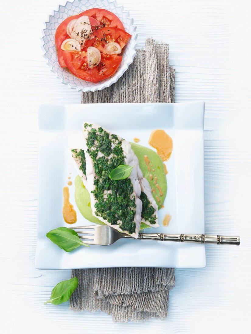 Fish fillet in an herb crust with pea sauce