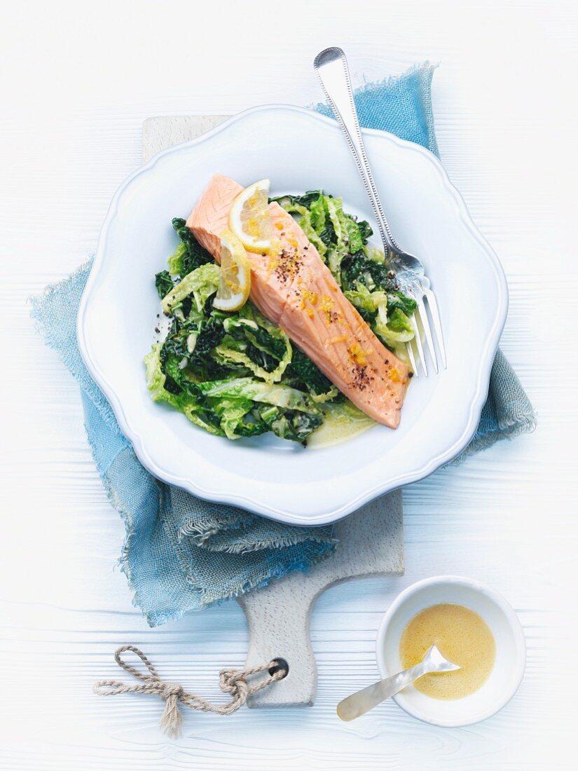 Warm salmon fillet on savoy cabbage