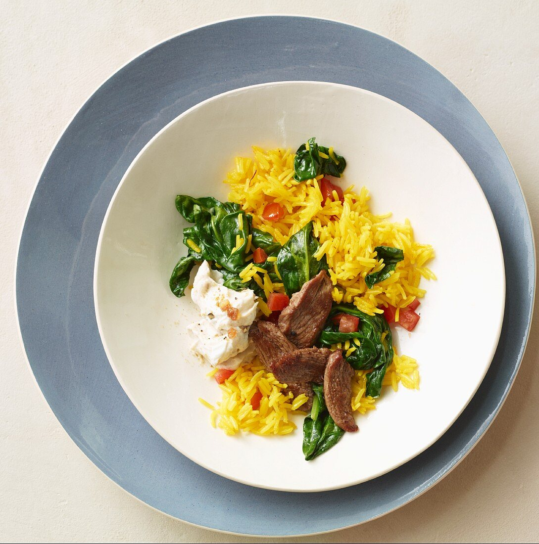 Saffron rice with spinach and beef