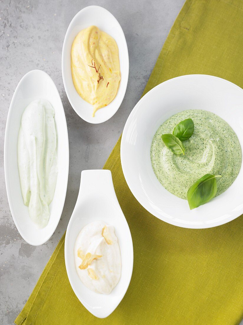A variety of mayonnaise: basil mayo, aioli, Asian mayonnaise, saffron rouille