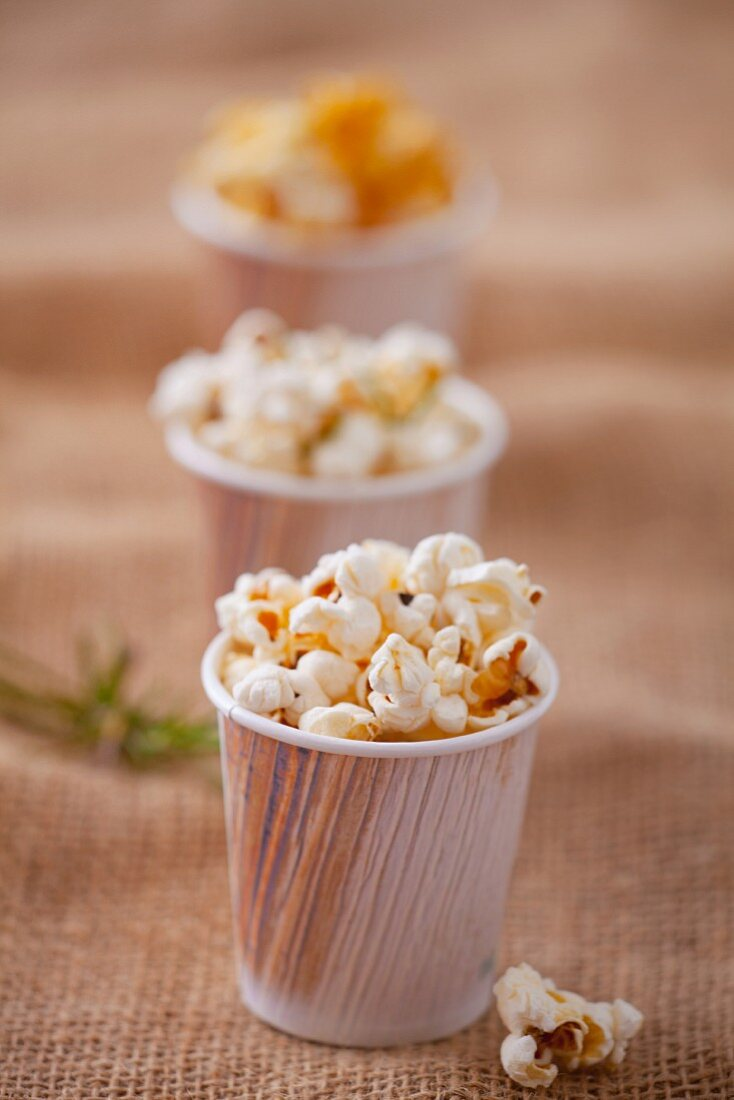 Caramelised popcorn in paper cups