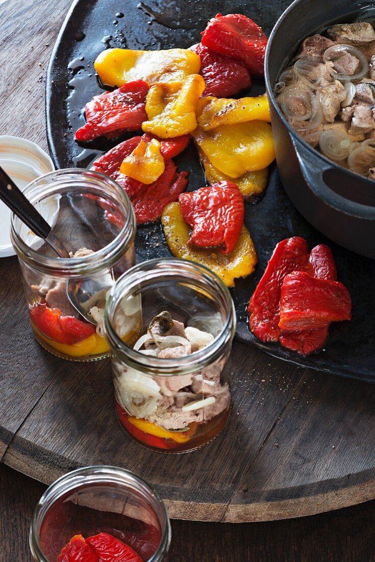 Ragu di vitello being spooned into storage jars