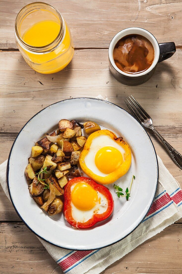 Eggs Baked in Red and Yellow Bell Peppers with Home Fries; Coffee and Orange Juice