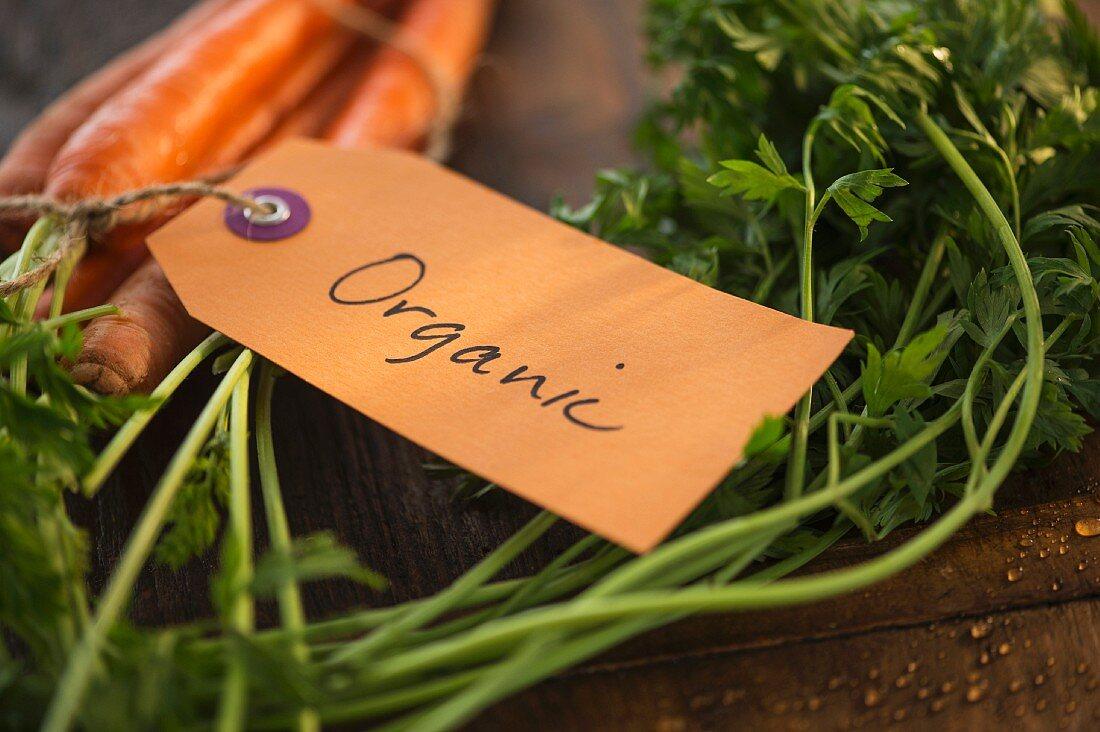Fresh carrots labelled 'Organic'