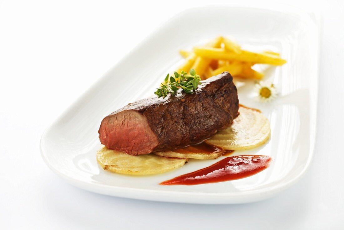 Saddle of venison with fried sugar beet, potato pasta and cornelian cherry coulis