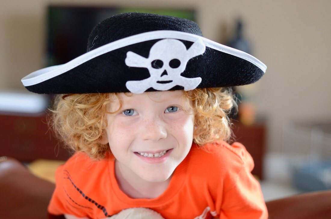 A boy wearing a pirate hat