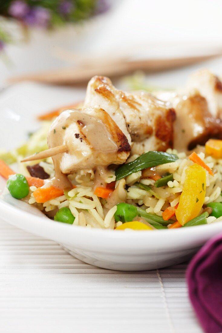 Turkey skewer on a bed of vegetable rice
