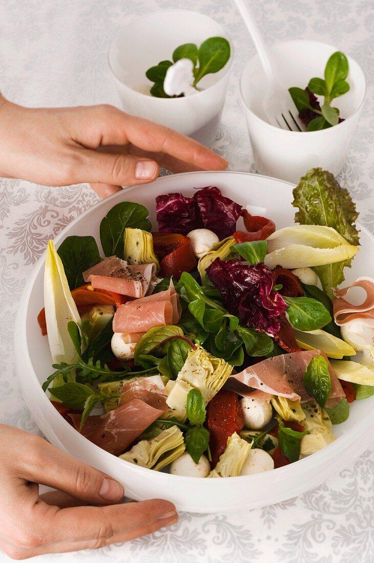 Artichoke salad with mozzarella and prosciutto