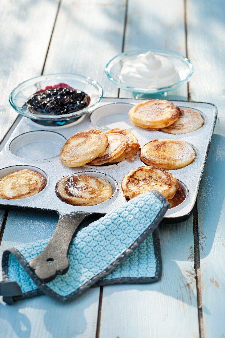 Pancakes with cream and berry sauce (Scandinavia)