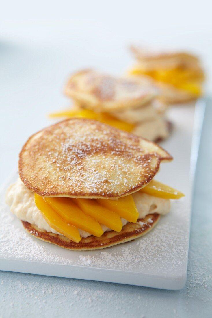Blini sandwich with mango and cream cheese