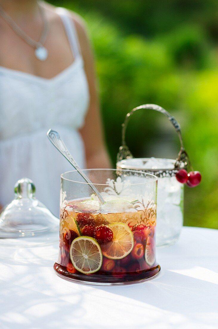 Summer cherry cooler on the garden table