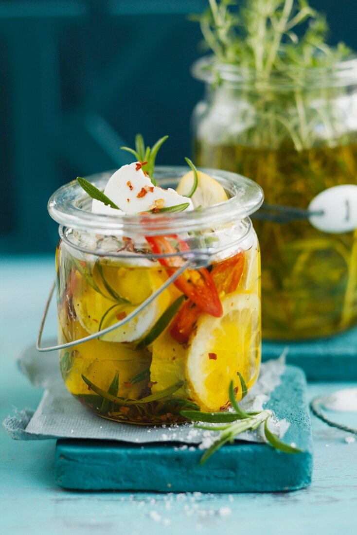 Pickled goat's cheese with fresh herbs