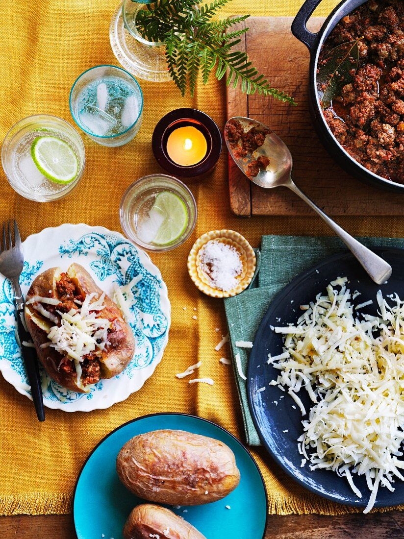 Jacket potatoes with bolognese and cheese