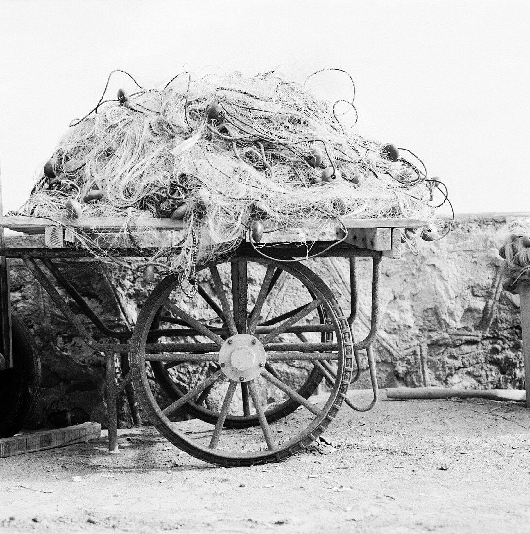Fishing nets on an old wooden cart (Salina, Aeolian Islands, Italy)