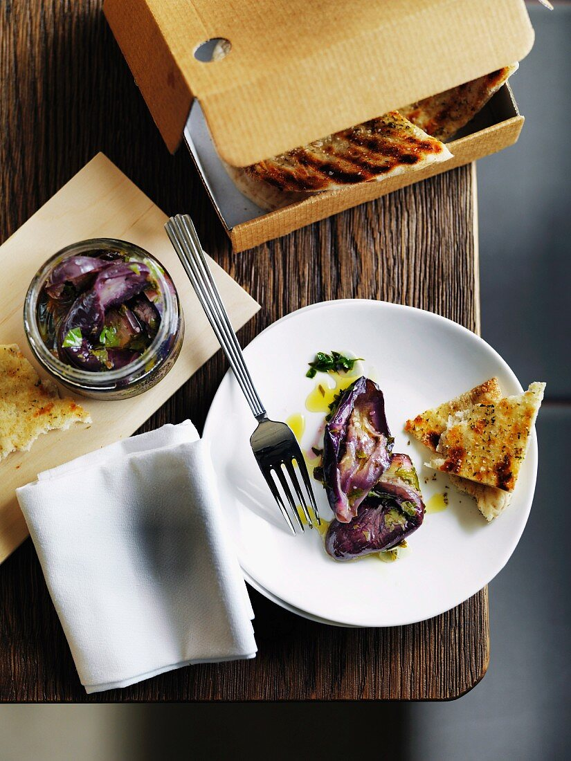 Pickled aubergines and grilled unleavened bread