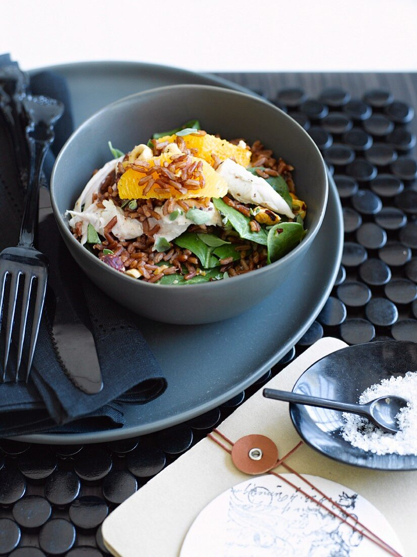 Red rice salad with chicken, oranges and spinach