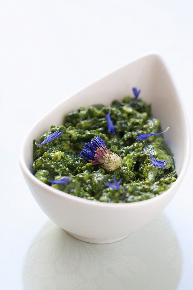 Avocado sauce with hemp oil and cornflowers