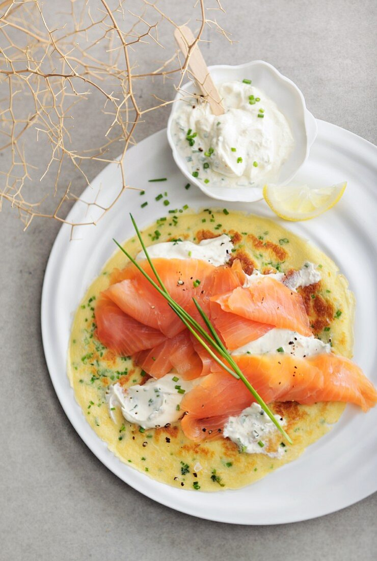 A crepe topped with smoked salmon and creme fraiche (seen from above)