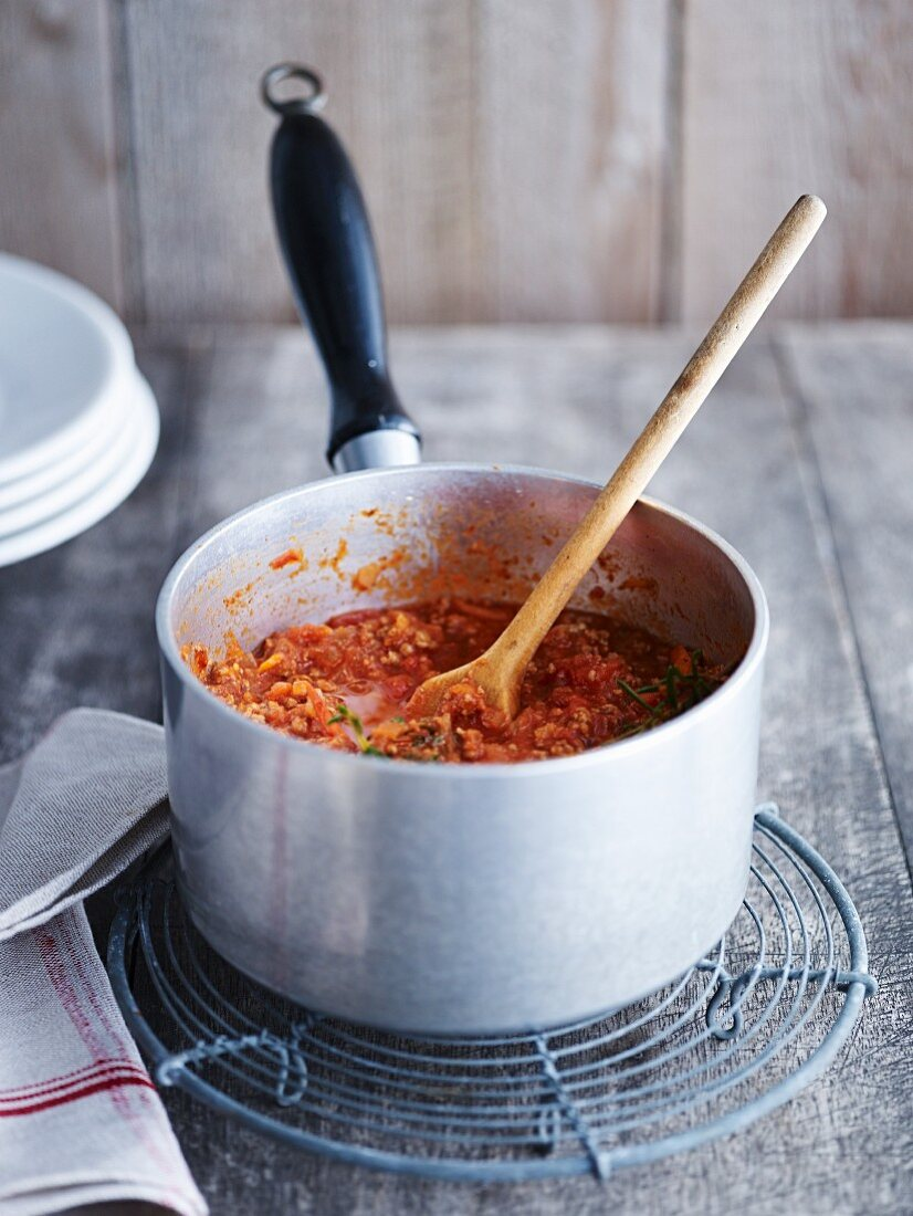 Bolognese sauce in a pan on a wire rack