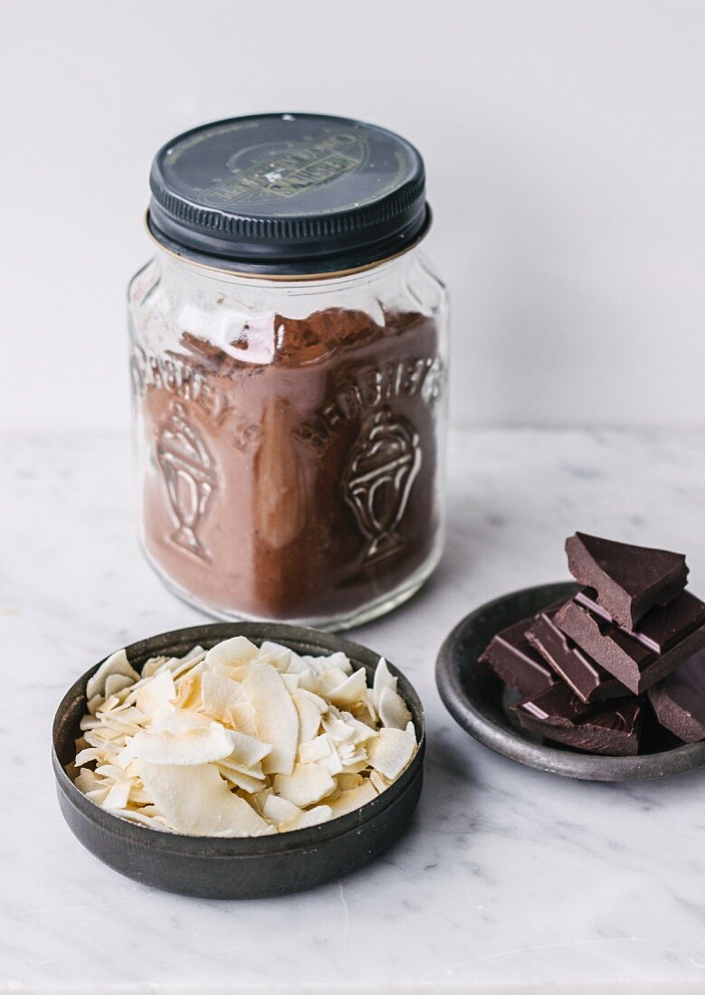 Grated coconut, chocolate chunks and cocoa powder