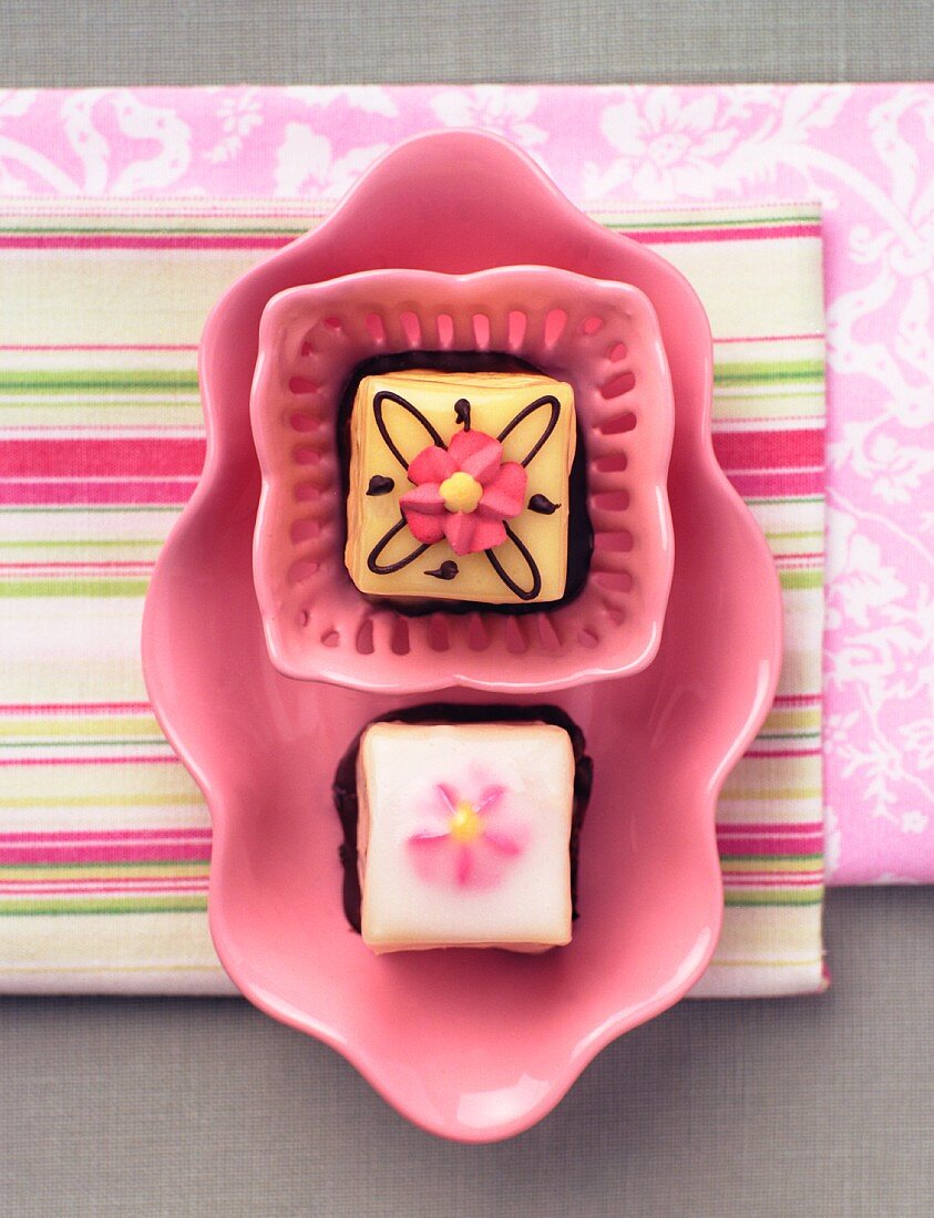 Petit fours on a pink plate