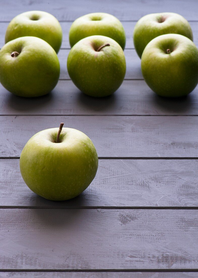 Green apples lined up