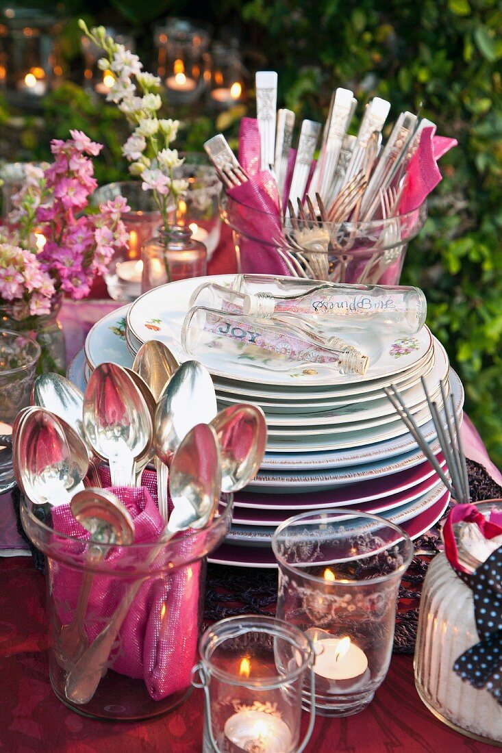 Crockery and cutlery on a table at a garden party