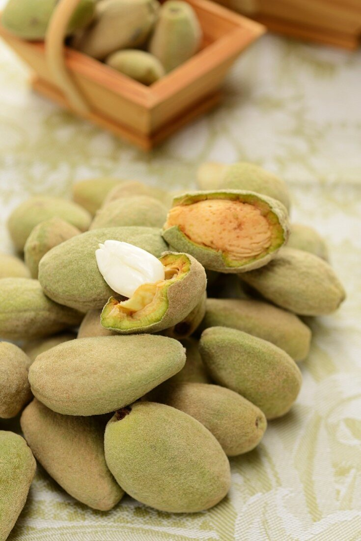 Fresh almonds, one cracked